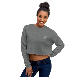 "Female model wearing Grey Xoo Life crop sweatshirt with small, grey  embroidered ""x"" on left chest"