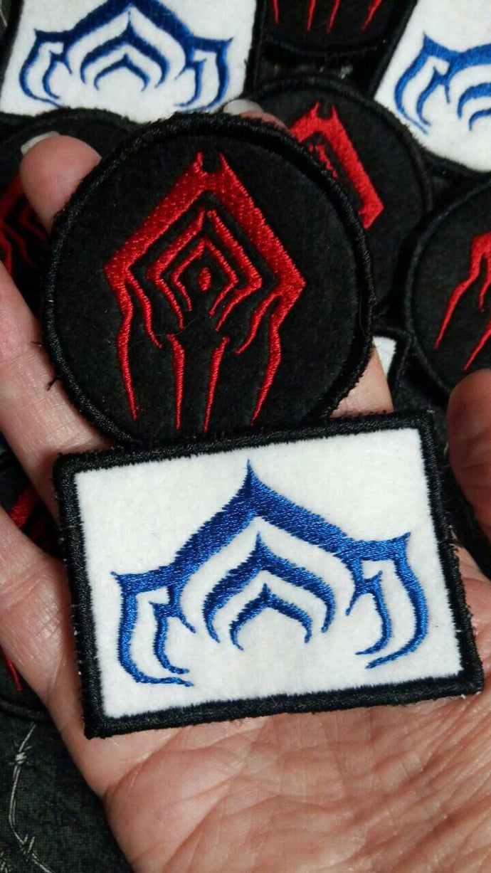 Warframe Lotus and Stalker patches (Inspired by source material)