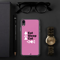 pink iphone case eat sleep cat repeat on dark grey background beside a pen to the left a watch to the right and black rimmed glasses above