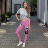 young women's workout outfit loose fitting light grey top and pink leggings with eat sleep cat logo on upper right leg and purfit brand on left