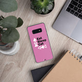 black border pink samsung phone case slim on desk with a laptop on the right one dark grey and one tan notebook below and two plants