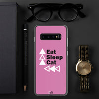 black border pink samsung phone case slim on dark grey background with a watch to the right a pen to the left and black rimmed glasses above
