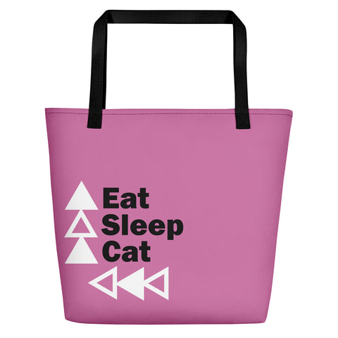 pink tote bag with black handles and eat sleep cat logo in lower right corner