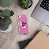 pink iphone case eat sleep cat repeat beside laptop