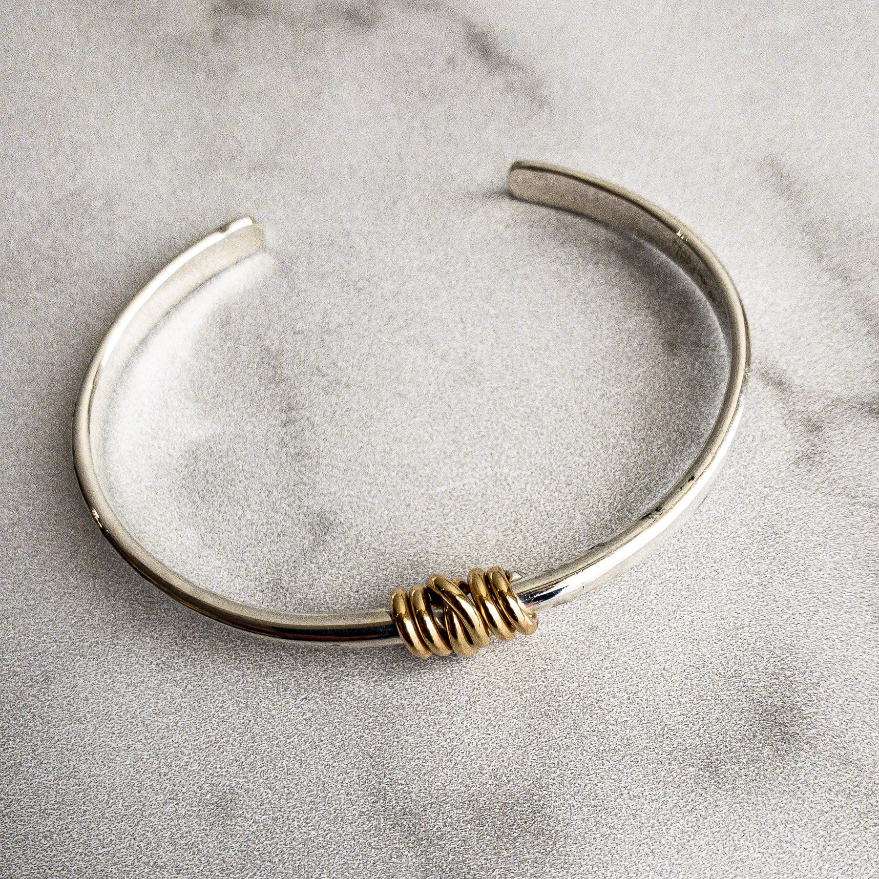 Silver Bracelet with Gold Knot