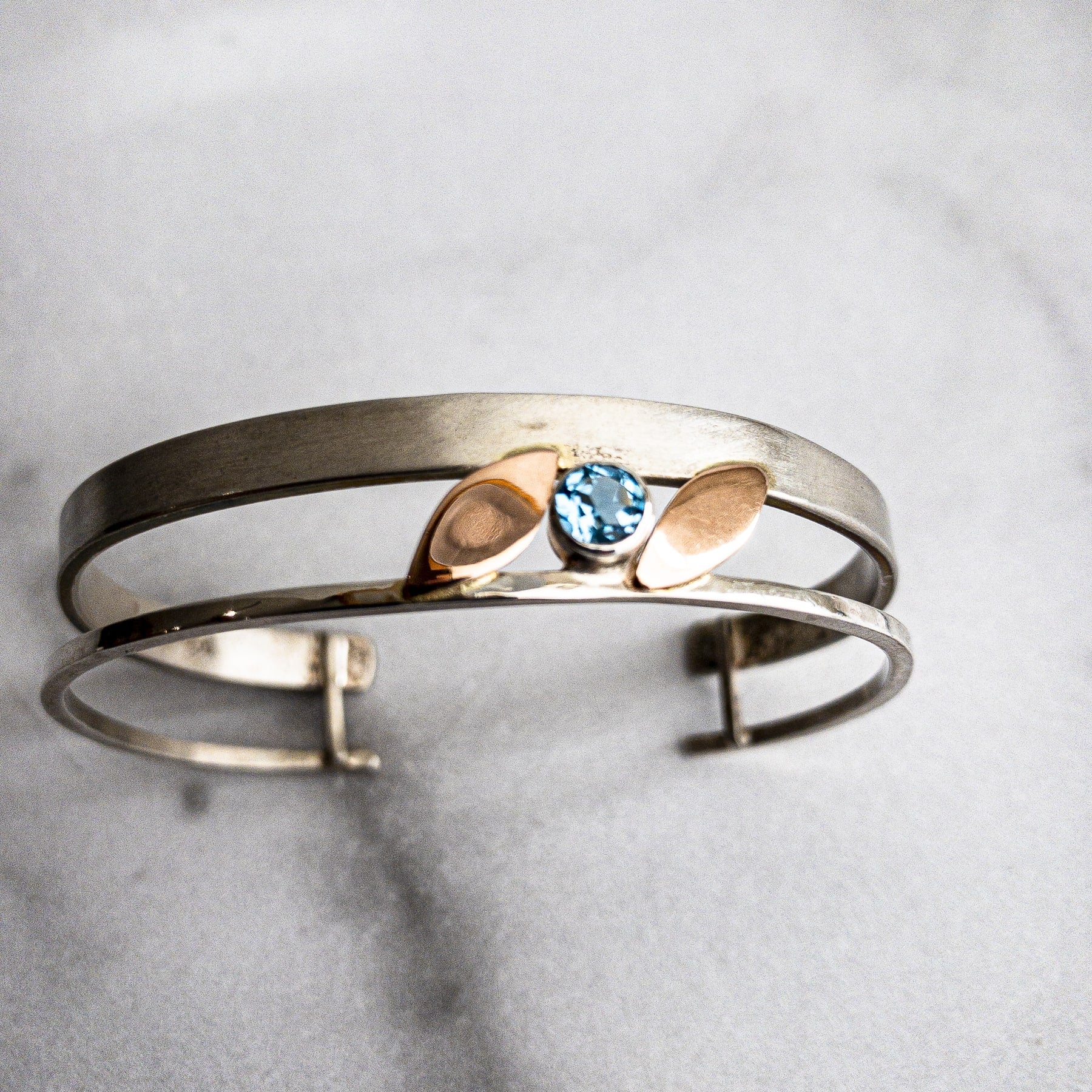 Small SS Cuff with Blue Topaz and Gold Leaf