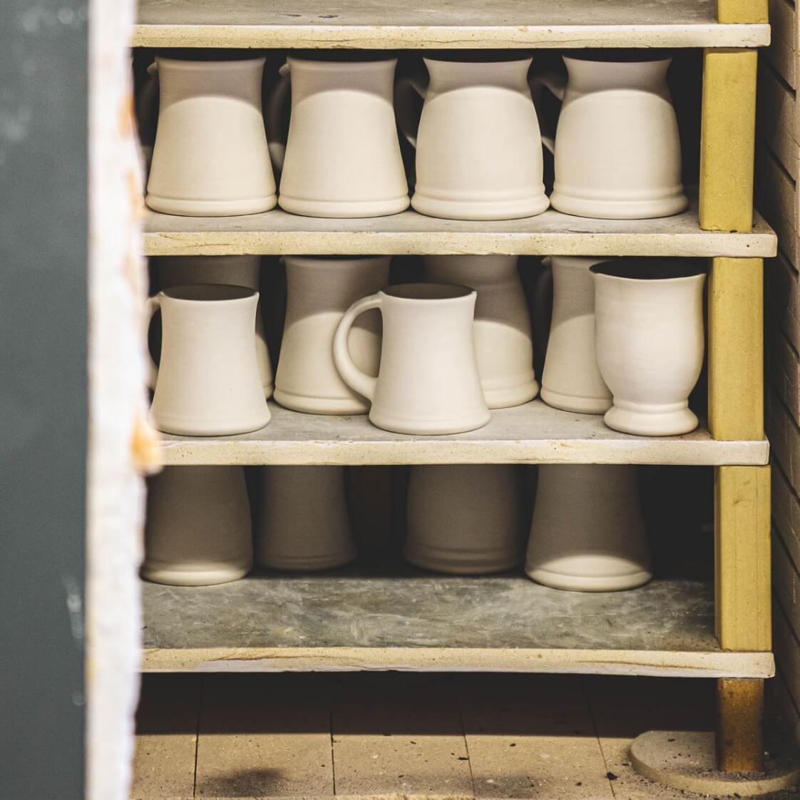 preview of mugs in a kiln