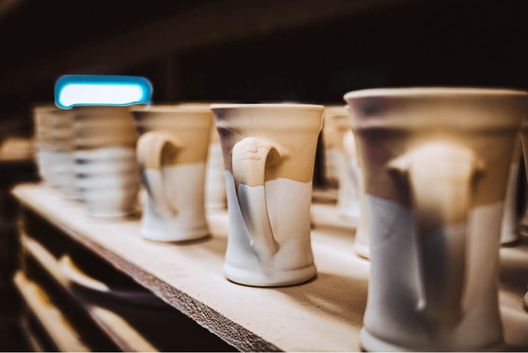 deco mugs on a kiln self
