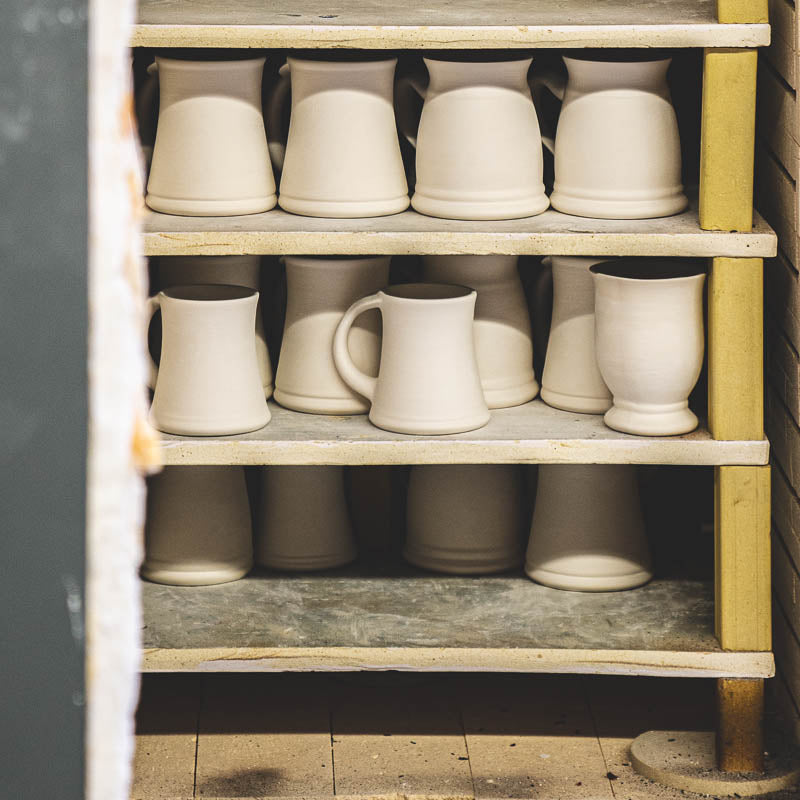 the whale tail pottery mug in a bisk kiln