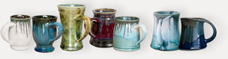 assortment of pottery mugs