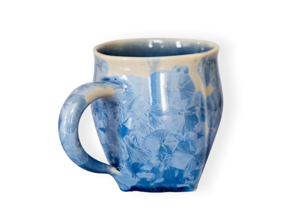 The wave pottery mug shown in baham blue.