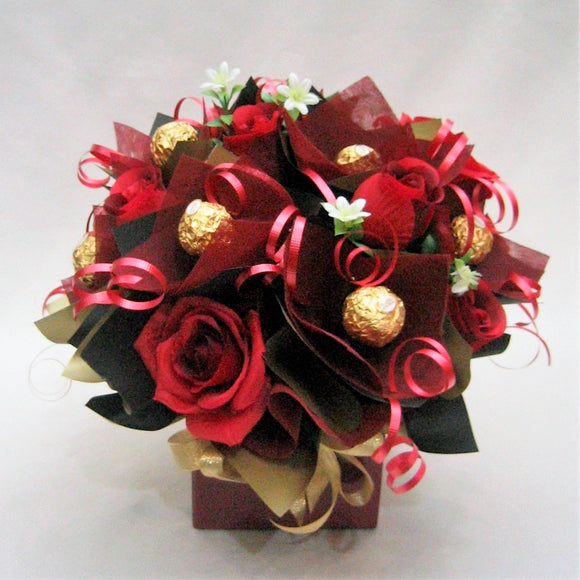 Chocolate box with artificial flowers
