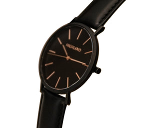 Minimal black wrist watch with black leather strap for men