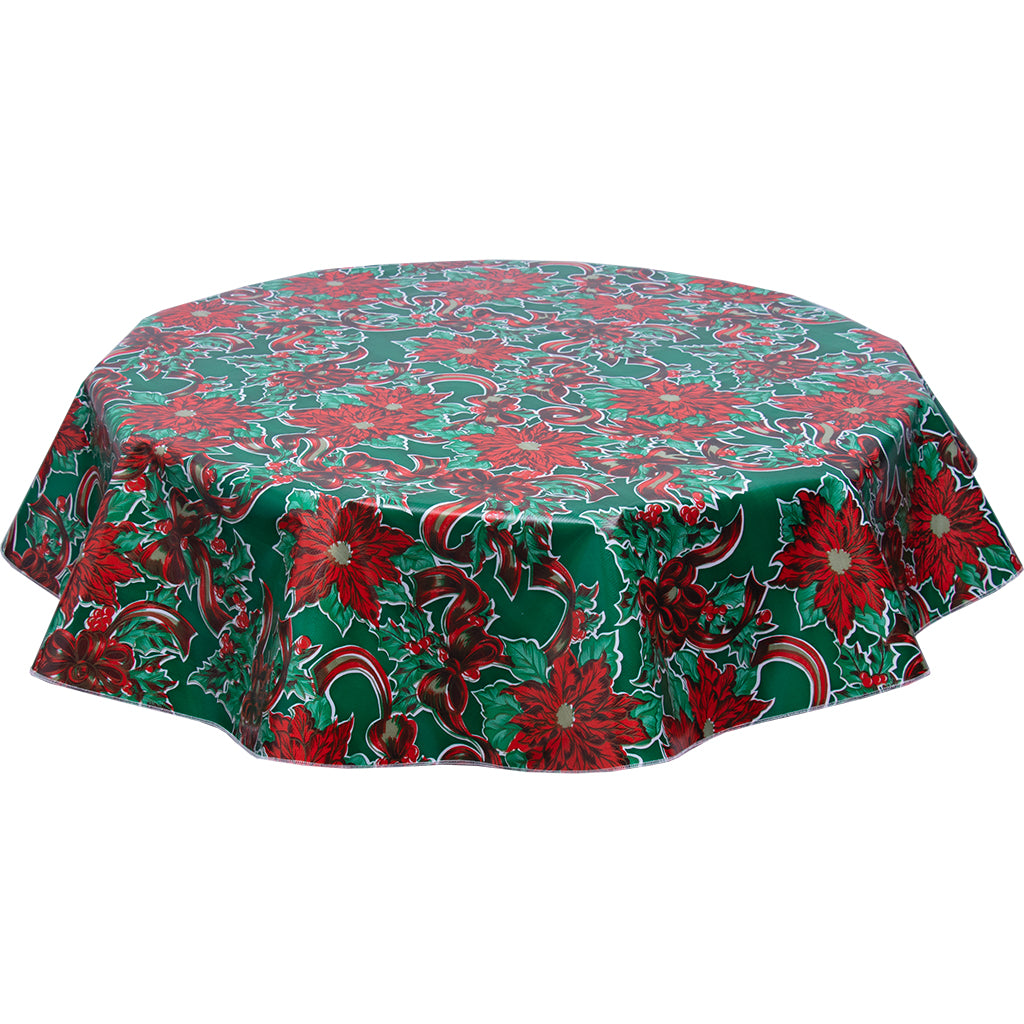Christmas ribbons and Holly on Green tablecloth