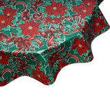 round tablecloth Christmas ribbons and holly on green