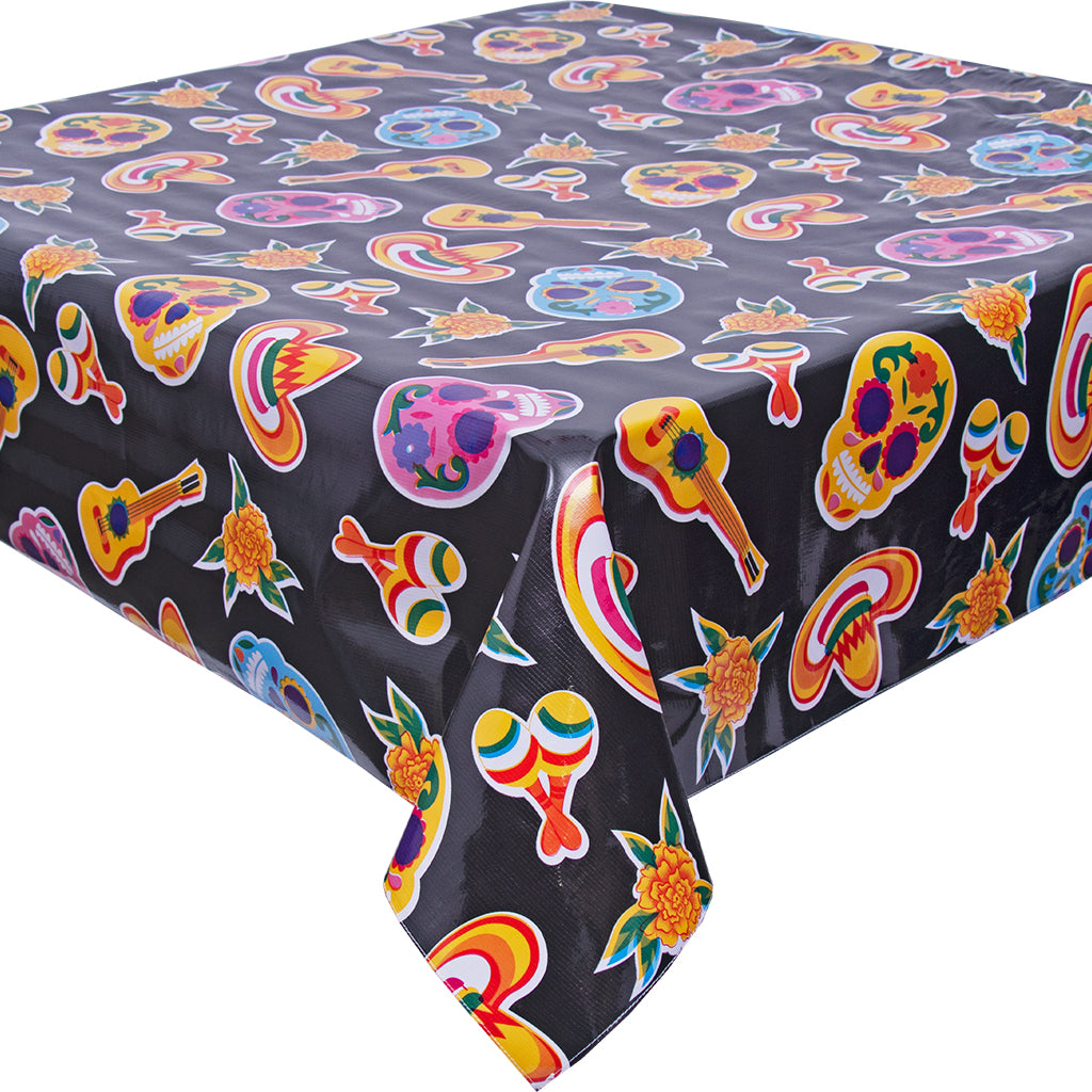 freckled sage skulls on black tablecloth