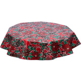 freckled sage Christmas tablecloth holly and ribbons on red