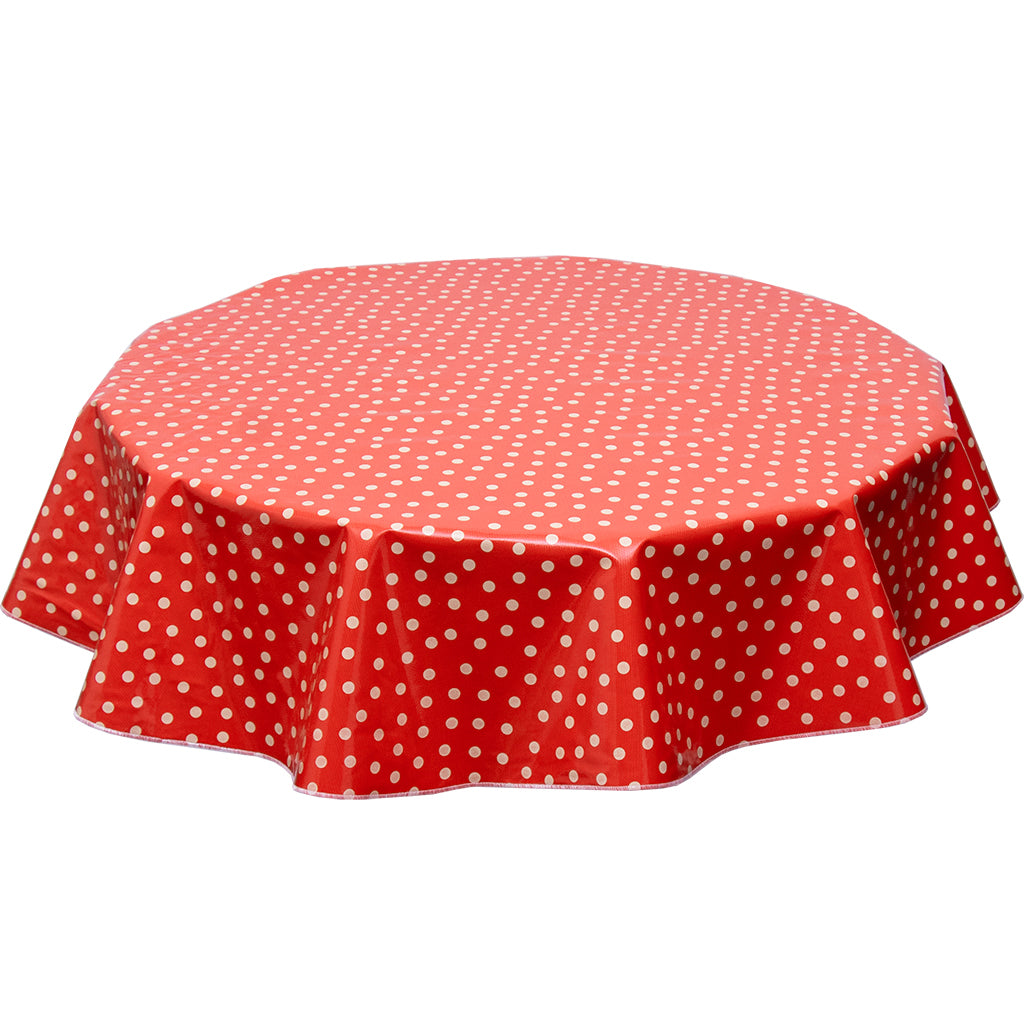 freckled sage round oilcloth tablecloth in tan dot one solid red