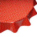 freckled sage tan dot on red round tablecloth