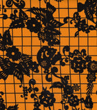 Round Oilcloth Tablecloth in Day of the Dead Black on Orange