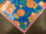 Slightly Imperfect 68x102 Oranges Blue Oilcloth Tablecloth with Red Gingham Trim