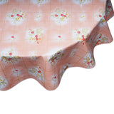 round oilcloth tablecloth bows and bouquet on salmon