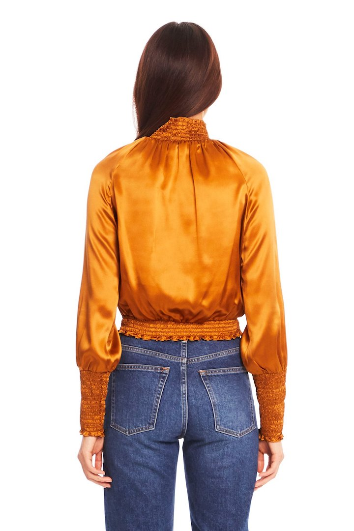 Model wearing Amanda Uprichard Bentley top with denim back view