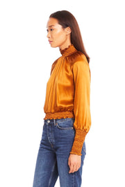Model wearing Amanda Uprichard Bentley top with denim side view