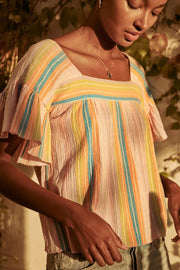 Image of model wearing the SAYLOR Arbor Top in Sherbet, standing outside, front view