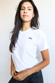Image of model wearing the NATION LTD Vote Tee standing infront of white wall, front view