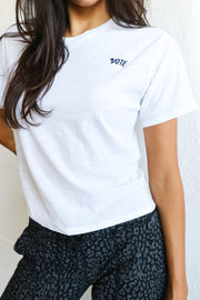 Image of model wearing the NATION LTD Vote Tee standing infront of white wall, front view close up of tee