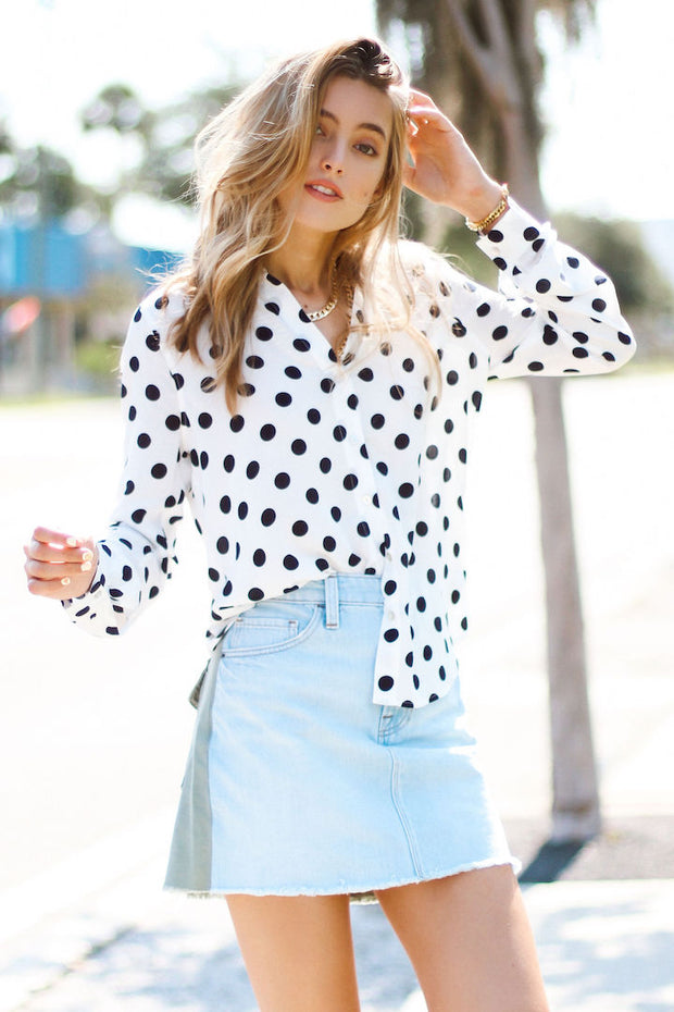 Model wearing le mini skirt cargo mix with polka dot top view