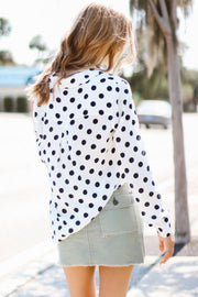 Model  wearing le mini skirt cargo mix with polka dot top back view