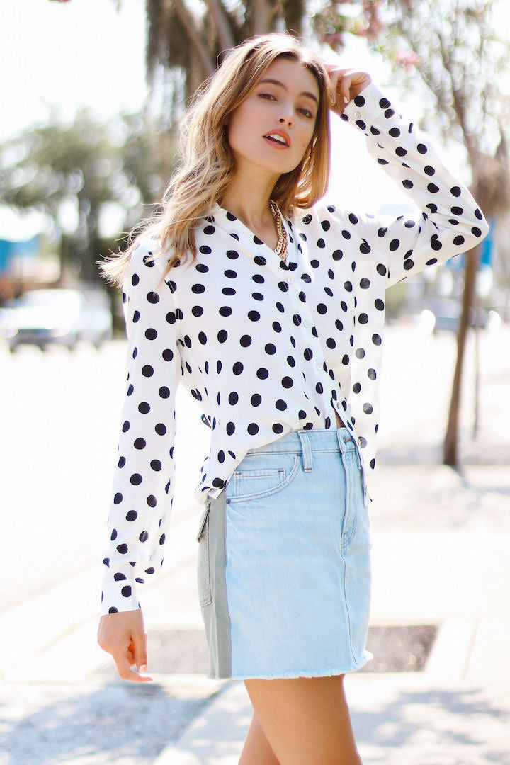 Model wearing Le mini skirt cargo mix with polka dot top with left hand in her hair