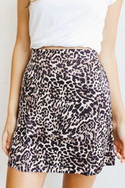 Image of model wearing the NATION LTD Birdie Skirt, standing infront of white wall, close up