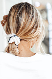 Model wearing Silk Scrunchie in ponytail, back of head view shoulders up