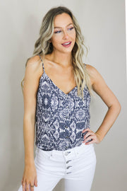 Woman is posing with hand on hip wearing the Aiden Snake Print Cami