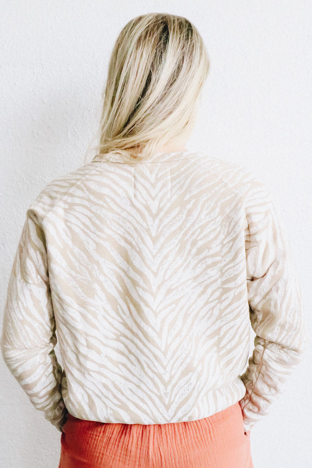 Image of model wearing the MOTHER The Hugger standing infront of white wall, back view