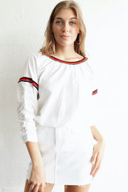 Image of model wearing SUNDAYS Reggie Popover Top standing against white wall front view with both arms by sides