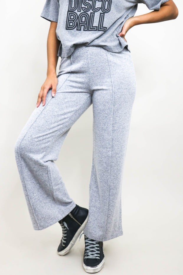 Model wearing Wide Leg Pants front view shoulder down with left leg bent