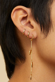 Image of the JENNY BIRD Foli Drop Earrings, on model's ear