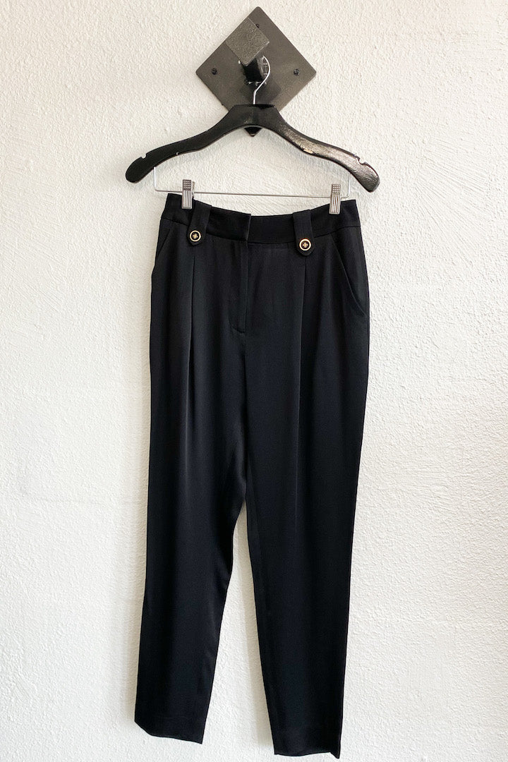 Image of the VERONICA BEARD Riana Pant, hanging against white wall, front view