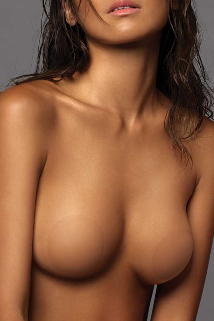 Image of B-SIX Nipple Covers- Size 1 Caramel on model against grey background