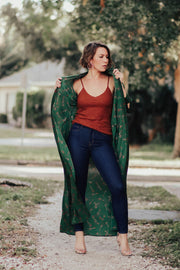 Model wearing L'agence Piper jean with cami and duster under a tree