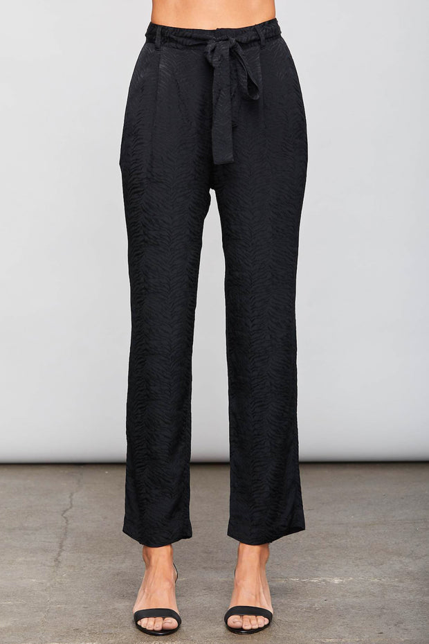 Image of model wearing the SUNDAYS Malone Pant, standing infront of grey backdrop, front view