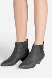 Image of model wearing ASH Cosmos Booties side view facing the left against white background