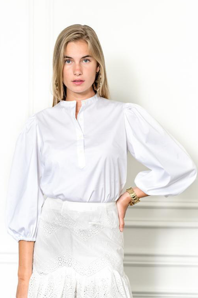 Model wearing The Shirt white puff sleeve button down top in white