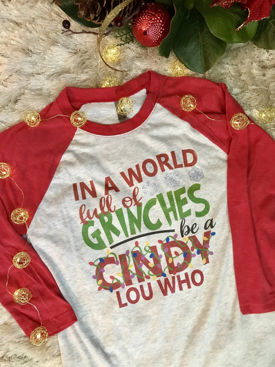 In A World Full Of Grinches Be A Cindy Lou Who Holiday Raglan Shirt