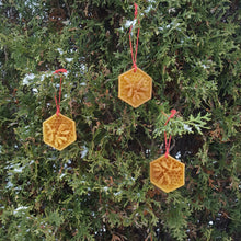 Load image into Gallery viewer, Beeswax ornaments on cedar tree.