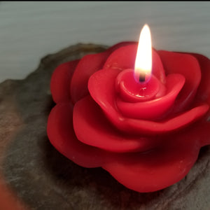 red rose candle burning